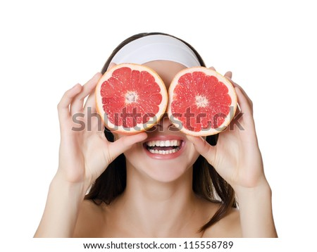 The beautiful woman with a grapefruit isolated