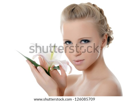 The beautiful woman with a lily flower