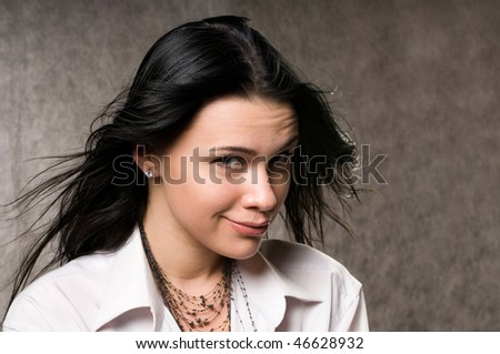 The beautiful woman with dark hair in a white shirt