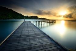 The beautiful wooden bridge with sunrise at national park Khao Leam Ya - Mu Ko Samet Rayong, Thailand