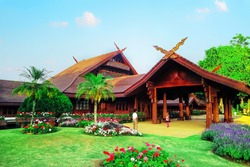 The beautiful wooden house surrounded with plants, Doi Tung Royal Villa in Chiang Rai, Thailand.