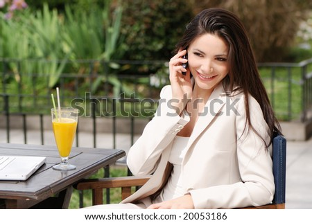 The beautiful young Business woman with movil