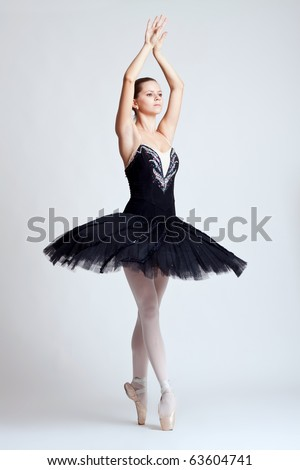 The beautiful young dancer. The ballerina posing.