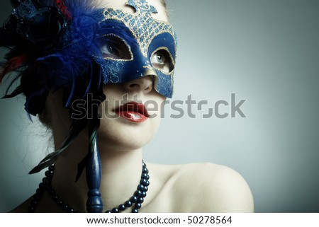 The beautiful young girl in a mysterious mask
