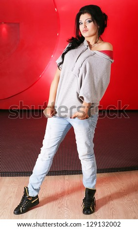 the beautiful, young girl in image hip-hop. Poses in a dance hall