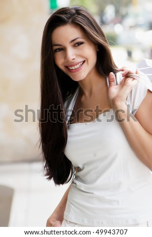 The beautiful young girl with a shopping Bag