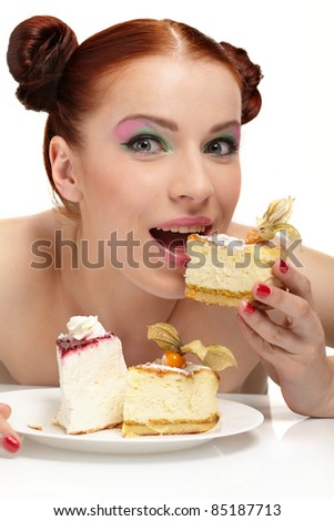 The beautiful young woman eat tasty cake - stock photo
