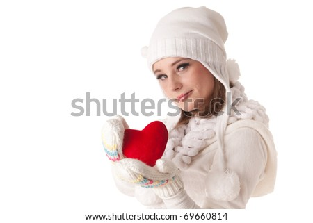 The beautiful young woman holds in hands a red heart on a white background. Selective focus on heart.