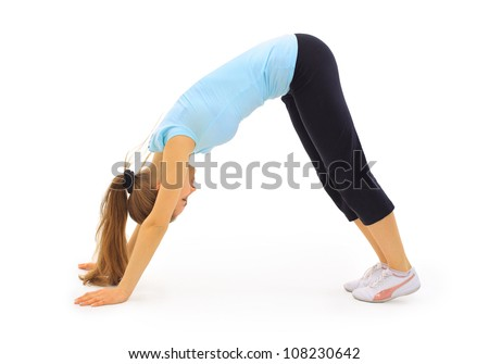 The beautiful young woman plays sports on a white background - stock photo
