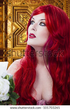 The beautiful young woman red haired in mysterious medieval room - stock photo