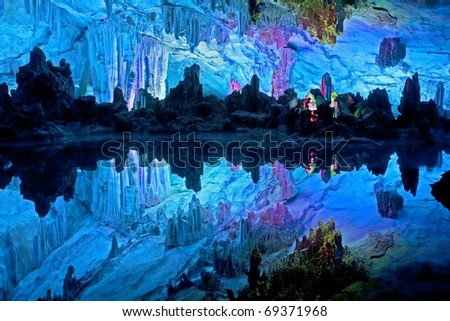 """The beautifully illuminated Reed Flute Caves displaying the """"Crystal Palace of the Dragon King"""" formations. Located in Guilin, Guangxi Provine, China - stock photo"""