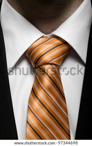 the beauty black business  costume with orange necktie, close up