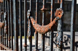 the beauty of blacksmithing in old rural cemeteries metal, brass and copper poppy flowers, balls, walled lattice lamps and inscriptions disappear under layers of rust