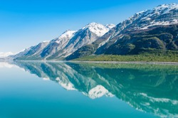 The beauty of North America | Alaska: Picturesque view of the mountains reflecting in still water of Glacier Bay in  Alaska, United States.