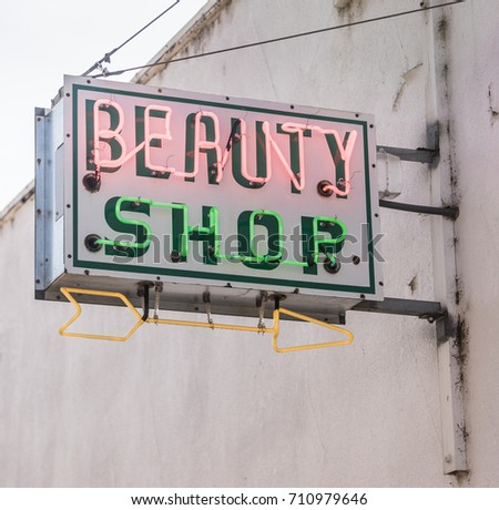 The beauty parlor is closed but the neon sign is on #710979646