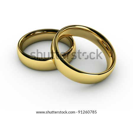 stock photo The beauty wedding gold rings on white background