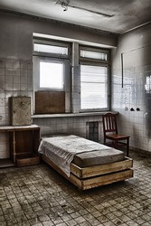 The bed in an abandoned hospital