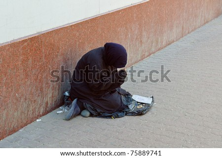 The beggar asks for alms on the street