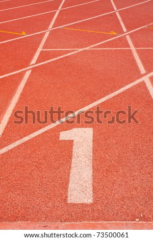 The beginning of the athletics track. the start of the athletics
