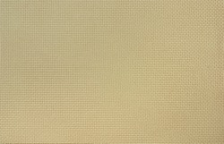 The beige Aida cotton fabric of uniform weave for cross stitch.