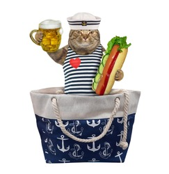 The beige cat in seaman clothing with a mug of light beer and a big hot dog is sittin in a bag. White background. Isolated.