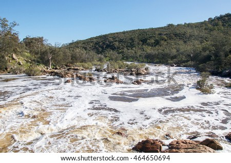 The Bell Rapids white water where the Avon and Swan River meet in Brigadoon in the Swan Valley region in Western Australia/Flowing Bell Rapids/Brigadoon, Swan Valley Region, Western Australia