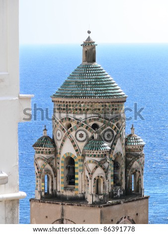 the bell tower of S. Andrea cathedral in Amalfi - Italy - against blue sea