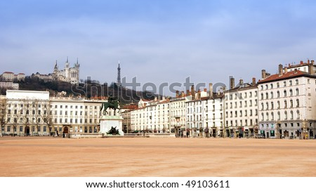 The Bellecour square in Lyon. Statue of Louis and Basilique Fourviere on a background. France.
