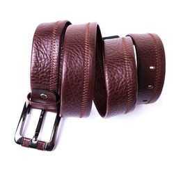 The belt is made of genuine brown leather with a grained texture with zigzag stitch. White background