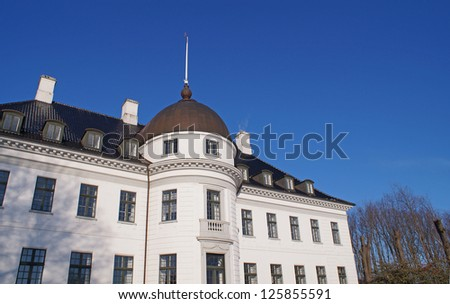 The Bernstorff Palace on a sunny winter day with clear blue sky