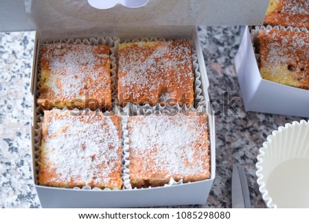 The best gift always come from your heart. Almond and vanilla cake cutting in square pieces. Decoration with a little icing. Family love, enjoy eating sweet, homemade.