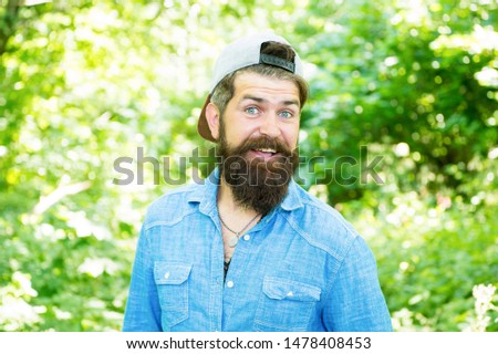 The best in male. male facial care. brutal man with beard. barber. hispter style. Fashion portrait of man. Hair beard care. guy in forest. summer camping. happy bearded man. Mature hipster with beard.