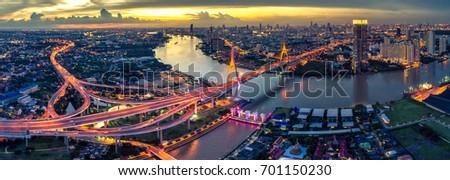 The Bhumibol Bridge (Industrial Ring Road Bridge) (Bangkok, Thailand) Beautiful view at twilight, Bangkok Expressway top view, expressway and motorway at night Aerial view from drone