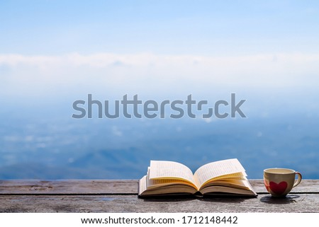 The Bible placed on the table was opened for learning to understand the Bible in order to pray to God and to ask God to protect himself and his family. The concept of Bible learning and faith in God