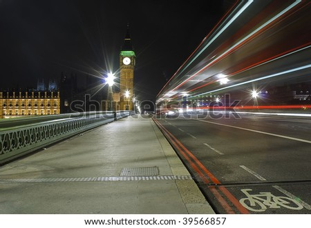 The Big Ben and Westminster Bridge at night with traffic light trails