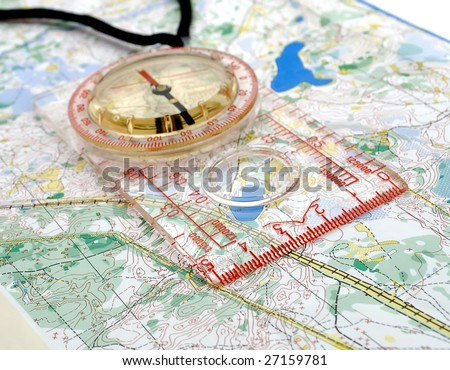The big compass on a sports map for orientation