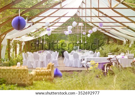 The Big Day - outdoor wedding party in old greenhouse with white tables and fresh nature decorations #352692977