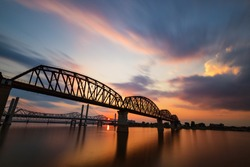 The Big Four Bridge that connected Kentucky and Indiana is an old railroad truss bridge, originally built in 1895, and was converted into a path for people to cross the Ohio River. Long exposure.