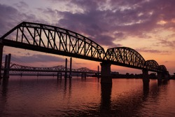 The Big Four Bridge that connected Kentucky and Indiana is an old railroad truss bridge, originally built in 1895, and was converted into a path for people to walk, run and bike across the Ohio River.