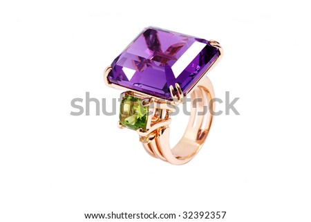 The big gold ring with an emerald and amethyst