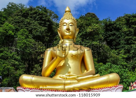 The big golden Buddha statue on hill, Phuket, Thailand