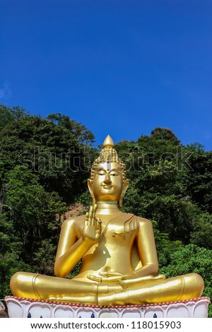 The big golden Buddha statue on hill with blue sky background, Phuket, Thailand