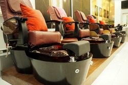 The big nail spa chair in the shop ready to service you