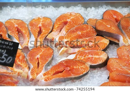 The big pieces of red fish on ice in the fish market