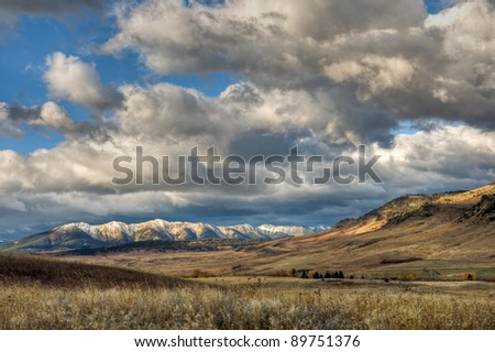 The big sky and fall colors along the West Boulder River, McLeod, Montana.