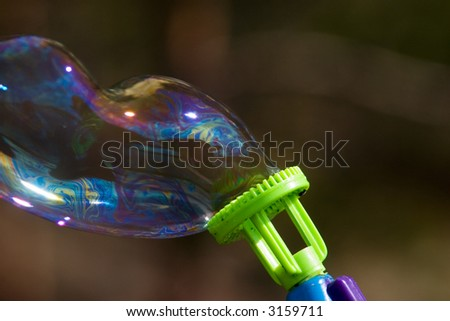 The big soap bubble from a toy pistol