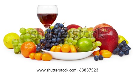 The big still-life with fruit and a wine glass on a white background