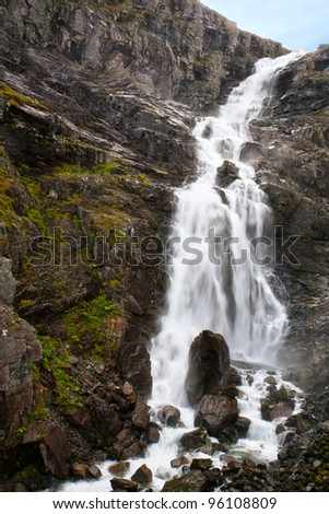 The big waterfall in mountains of Norway