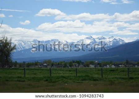 The Bitterroot Mountains provide a beautiful background for farms and ranches in the Bitteroot Valley near Hamilton, Montana.
