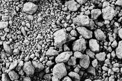The black and white background image of the pile of dry soil
